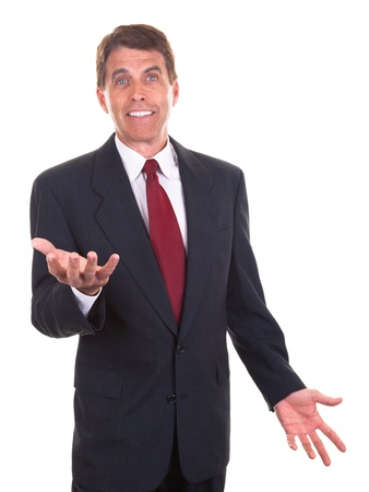 Middle aged businessman smiling and gesticulating with his hands. photo