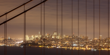 San Francisco through the cables of the Golden Gate bridge. photo