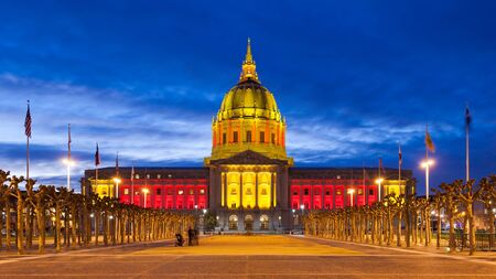 playoff: San Francisco City Hall in red and gold light in honor of the 49ers hosting an NFL playoff game. Stock Photo