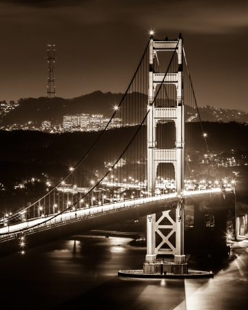 golden: The South tower of Golden Gate Bridge at night in black and white  Stock Photo
