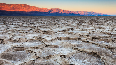 Sunrise panorama of the salt pans at Badwater Basin in Death Valley National Park, California  photo
