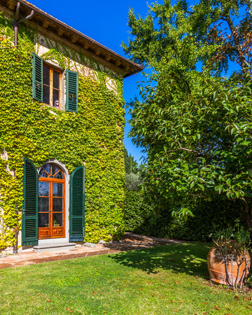 Beautiful winery on a sunny autumn day in Tuscany, Italy.