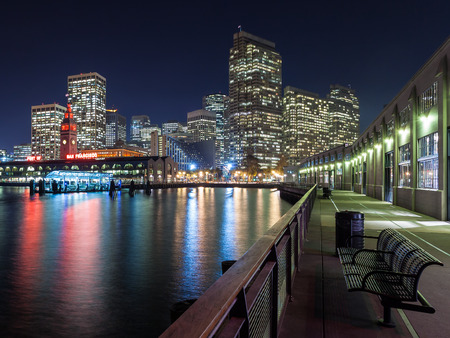 san francisco bay: View of the San Francisco skyline at night from one of the piers.