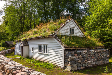 folk village: Traditional log farmhouse in the Norwegian Folk Museum in Oslo, Norway. Editorial