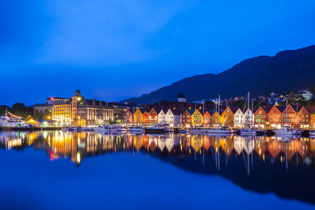 norway: The Bryggen Hanseatic Wharf across the fjord at night in Bergen, Norway.