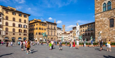 Busy summer day at the popular Piazza della Signoria on September 9 2014 in Florence, Italy Editorial