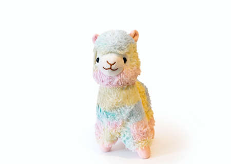 Soft alpaca plushie doll alpaca toy isolated on white background with shadow reflection. The concept of gifts for the holidays. Toy in the shape of an animal. Side wiew