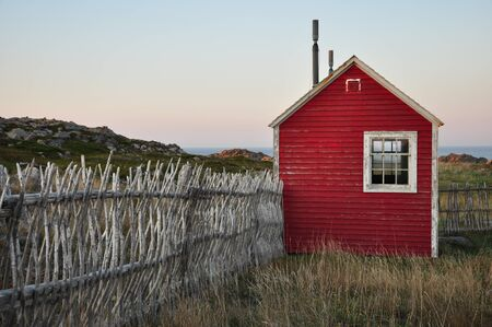 red shed with fence