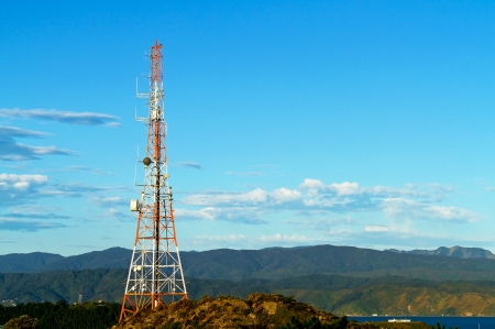 Communication Tower on mountain with blue sky photo
