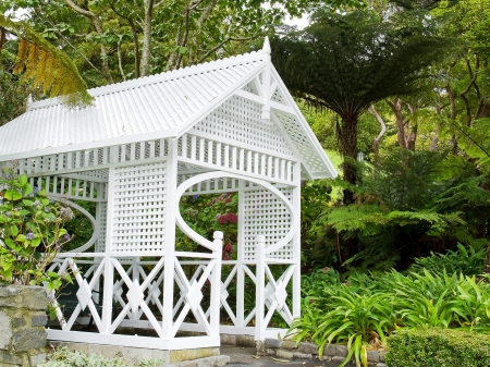 White wooden rest house in the botanic garden photo