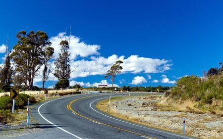 Panoramic color view of nice autumn empty road  Te Anau, South Island, New Zealand Stock Photo - 14492753