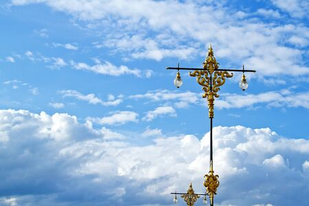Thai style street lamp standing in blue sky; Northern of Thailand photo