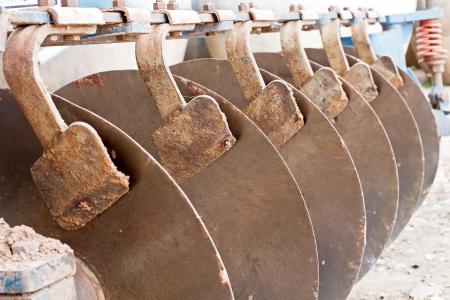 harrow: Close up of disk harrow sitting on ground