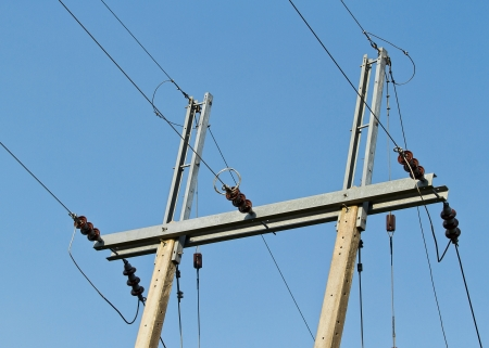 Electric power post with wire on blue sky background photo