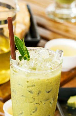 Cup of ice tea with fresh green tea photo