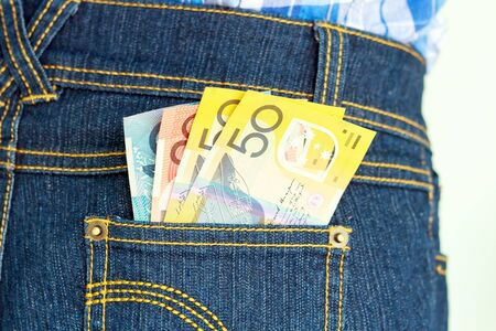 Australia banknote in jeans pocket looking out photo