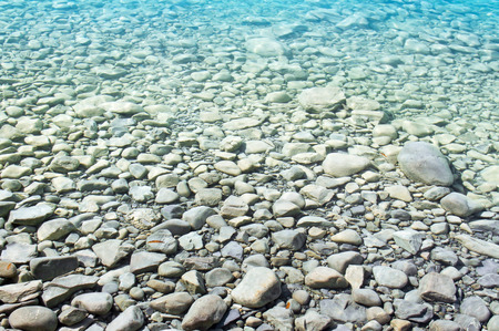 Transparency of water with pebbles photo