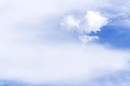 Softness blue sky background with heart shape clouds on nature composition photo