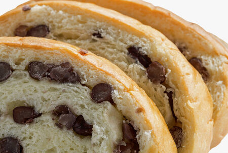 black bean: Macro view of sliced bread with black bean inside isolated on white  Stock Photo