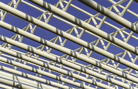 metal structure: Architecture of metal structure texture against on blue sky Stock Photo