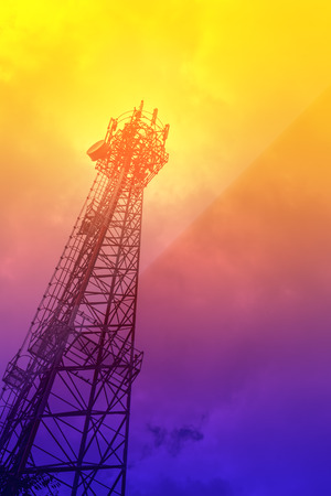 Telecommunications tower mobile phone base station in soft color background photo