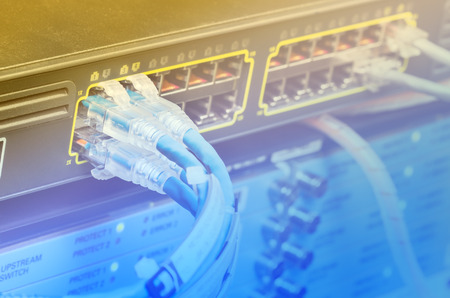 hub computer: Network switch and UTP ethernet cables in data center