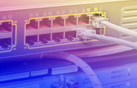 cat5: Network switch and UTP ethernet cables in data center