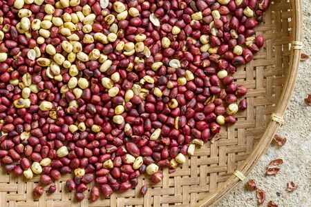 red skinned: Roasted peanuts background in bamboo basket Stock Photo