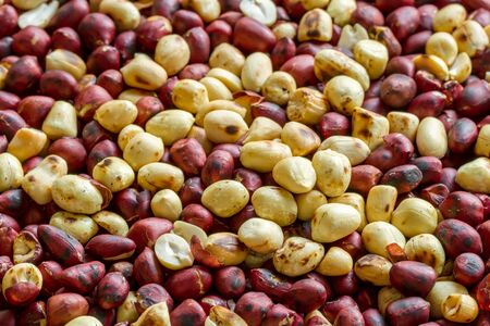 red skinned: Close up of roasted peanuts background