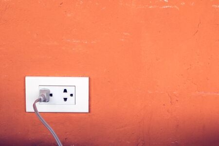 plugged in: Close up of power plug plugged in a wall socket