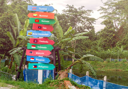 asean: AEC country name on multicolor wood signboard decorate on side the road
