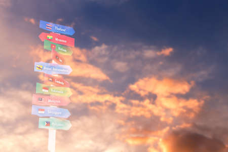 aec: AEC country name on multicolor wood signboard over golden sunset sky