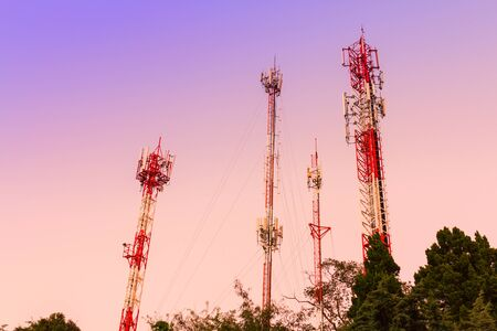 rural areas: Communication towers over sunset sky in rural areas