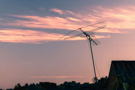 analogue: Outdated analogue TV antenna aerial against sunset sky
