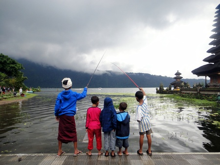 A group of friends fishing at Pura Ulun Danu Bratan Stock Photo