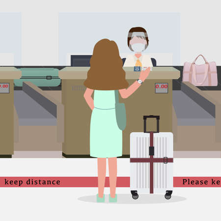 In new normal concept. Woman wear green dress going to check in at the airport and stand behind red line for keep distance. Staff at counter wear mask and face shield for spread of disease.