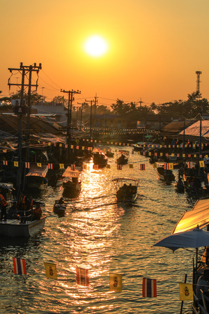 an agricultural district: Evening sun at Amphawa Floating Market,Amphawa district,Samut Songkhram Province,Thailand. Stock Photo