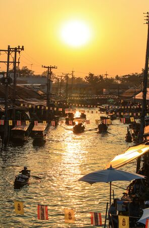 an agricultural district: Evening sun at Amphawa Floating Market,Amphawa district,Samut Songkhram Province,Thailand. Editorial