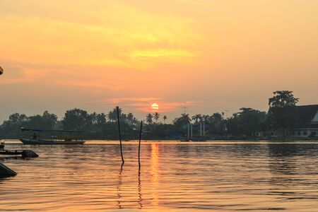 klong: sunrise at Mae Klong River,Amphawa district,Samut Songkhram Province,Thailand. Stock Photo