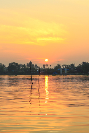 an agricultural district: sunrise at Mae Klong River,Amphawa district,Samut Songkhram Province,Thailand. Stock Photo