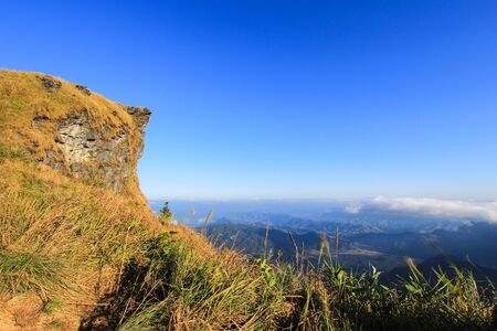 faa: Sunny day at Phu Chi Fa(a mountain area and national forest park in Thailand,a part of Doi Pha Mon,located at the northeastern end of Phi Pan Nam Range,Thoeng District,Chiang Rai Province) Stock Photo
