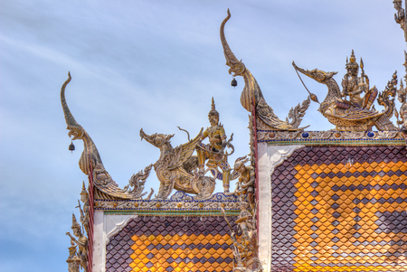 nakhon: beautiful stucco decorations at the roof of  Wat Sisa Thong ,Nakhon Pathom,Thailand