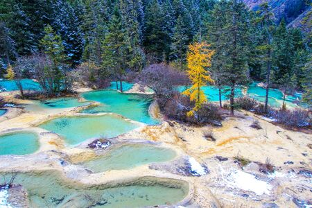 calcite: Huanglong National Park in the northwest part of Sichuan, China.known for its colorful pools formed by calcite deposits,as well as diverse forest ecosystems, snow-capped peaks, waterfalls and hot springs. Stock Photo