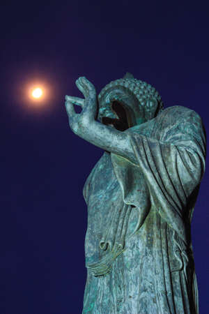 nakhon: full moon and Buddha statue at Phutthamonthon (Buddhist park in Nakhon Pathom Province of Thailand)