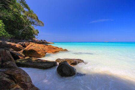 similan islands: the waves of crystal clear water at Tachai Island,Similan Islands National Park,Phang Nga Province,southern Thailand. Stock Photo