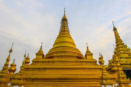 Sandamuni pagoda,Mandalay,Myanmar- known for its large golden pagoda, its hundreds of shrines containing inscribed marble slabs and the largest iron Buddha image in Myanmar. Stock Photo