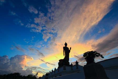 nakhon: sunset sky and Buddha statue at  Phutthamonthon(Buddhist park in Nakhon Pathom Province of Thailand)