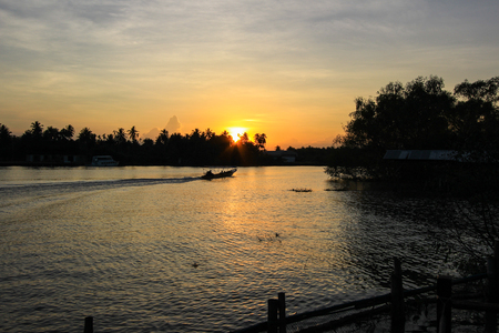 an agricultural district: sunset at Mae Klong River,Amphawa district,Samut Songkhram Province,Thailand.
