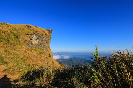 northeastern: Sunny day at Phu Chi Fa(a mountain area and national forest park in Thailand,a part of Doi Pha Mon,located at the northeastern end of Phi Pan Nam Range,Thoeng District,Chiang Rai Province) Stock Photo
