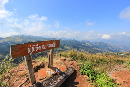 tanga: Doi Pha Tang-a viewpoint on top of a high cliff located in Wiang Kaen district,Chiang Rai,Thailand.  Non English texts meanthose who conquer Doi Pha Tang,hill 103 and1,653 meter from sea level